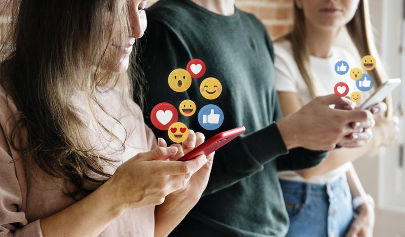 people using social media on their phones